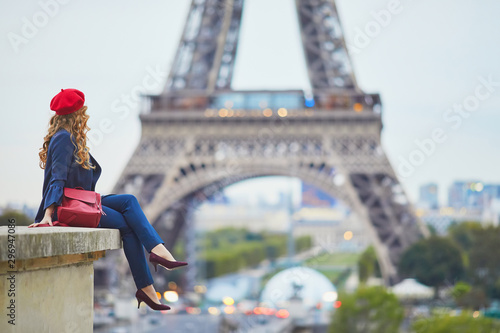 Young woman with long blond curly hair in Paris, France - 296947086