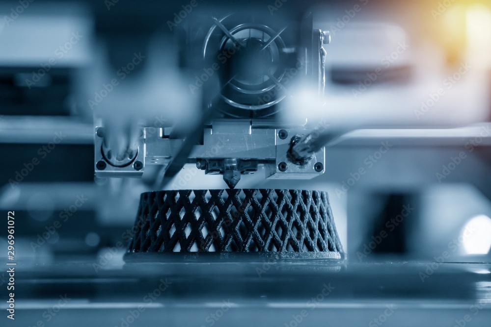 Fototapeta The 3D printing machine make the 3D prototype model by resin material. The hi-technology for rapid prototype method by 3d printing machine.