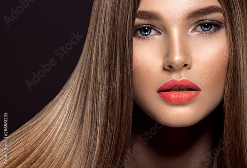 Woman with beauty long brown hair. Beauty woman with living coral color lipstick on lips.