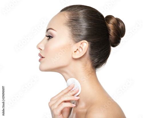 Fototapety, obrazy: Beautiful woman cleans the neck with  cotton swab.