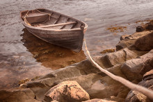An Old Fishing Boat Is Tethered Near The Shore Of The White Sea. Selected Focus. Toning.