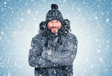 Smiling Happy Bearded Man In Winter Clothes Warms His Hands, Cold, Snow, Frost, Blizzard