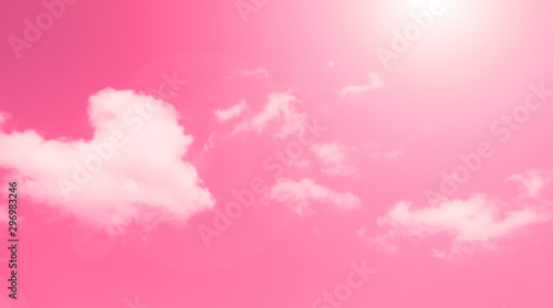 Wall Murals Candy pink Bright beautiful background of red sky with white clouds.