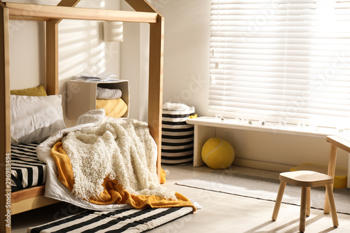 Fotografiet  Cozy child room interior with comfortable bed