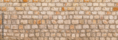 Fotomural Texture of unshaped brown stone wall pattern, made of rocks