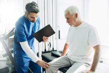 Physiotherapist Exam Patient's Knee. Senior Patient With Knee Injury Visit His Physiotherapist