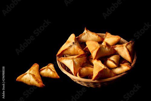 Vászonkép Fatayer - Stuffed baked spinach pies in basket black background