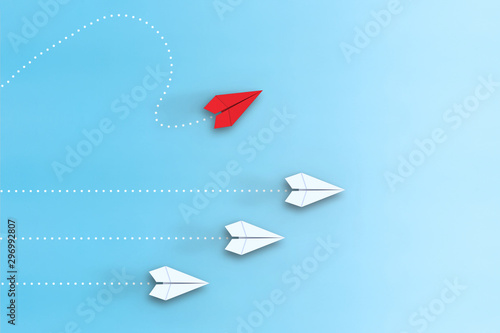 Fototapeta Leadership concept with red paper plane leading among white on blue background obraz na płótnie