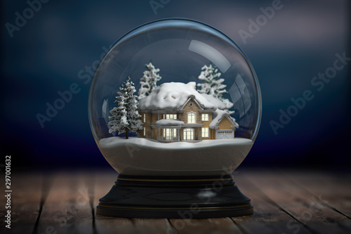Pinturas sobre lienzo  Glass snow globe and a house with lights in windows in the night.