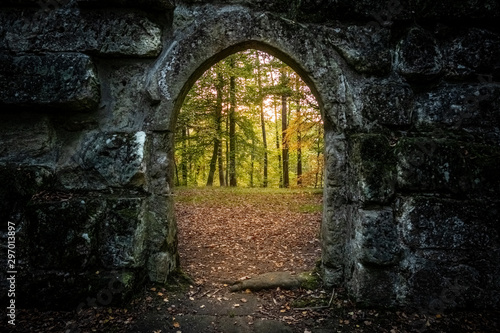 archway with autumn forest behind Wallpaper Mural