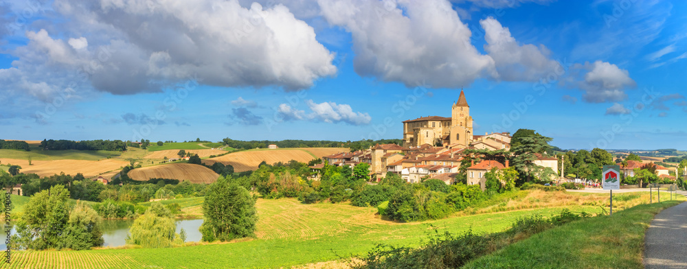 Fototapeta Summer landscape - view of the village of Lavardens labeled Les Plus Beaux Villages de France (The Most Beautiful Villages of France), the region of Occitanie of southwestern France