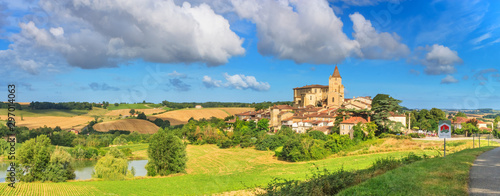 Tuinposter Oude gebouw Summer landscape - view of the village of Lavardens labeled Les Plus Beaux Villages de France (The Most Beautiful Villages of France), the region of Occitanie of southwestern France