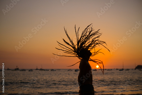 dreadlock young man in sunset Canvas Print
