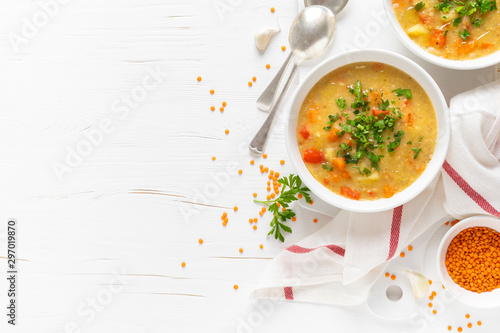 Fototapeta Vegetarian vegetable lentil soup with fresh parsley, healthy eating, top view