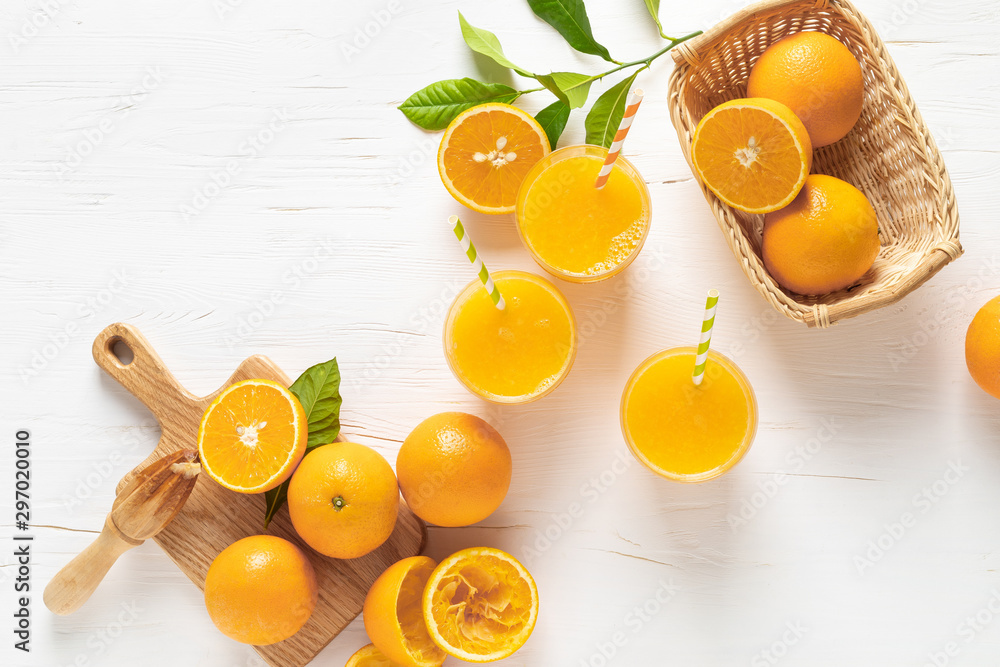 Fototapety, obrazy: Orange juice. Freshly squeezed juice in glasses and fresh fruits with leaves, view from above