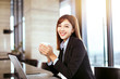 young business woman working in office