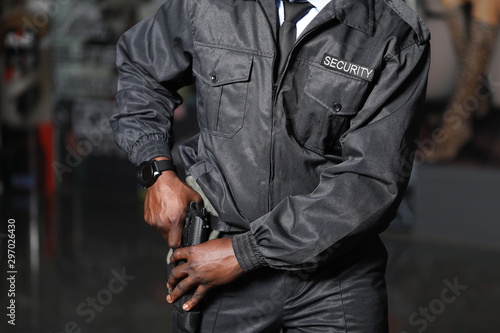 Fotografie, Tablou African-American security guard working in building