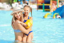Woman With Her Little Daughter Resting In Aqua Park