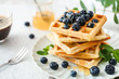 canvas print picture - Plate with sweet tasty waffles on white table