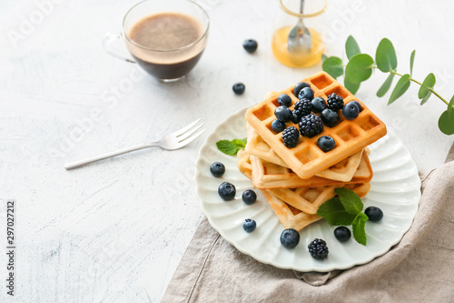 Fotomural  Plate with sweet tasty waffles on white table