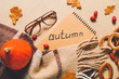 canvas print picture Beautiful autumn composition with notebook, scarf and glasses on color background