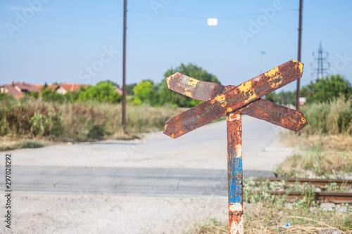 Valokuva Level crossing sign, called crossbuck, saltire or Saint Andrews cross, rusted, s