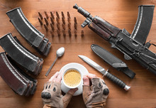 Breakfast Of An Arny Soldier Or Terrorist. Hands In Military Gloves Holds A Coup Of Coffee.
