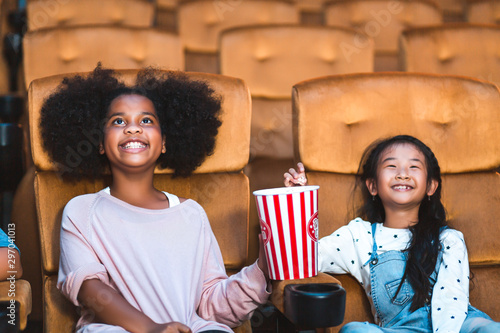 Fotografie, Obraz  Happy kid watch movie in theater