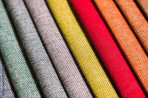 Fototapeta Colorful and bright fabric samples of furniture and clothing upholstery. Close-up of a palette of textile abstract diagonal stripes of different colors obraz