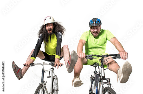 Two eccentric guys riding a bikes - team work фототапет