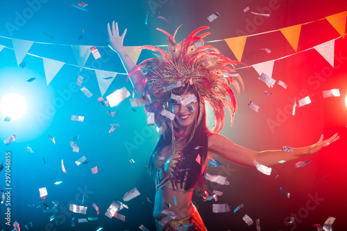 Carnival, dancer and holiday concept - Beauty brunette woman in cabaret suit and headdress with natural feathers and rhinestones Wallpaper Mural