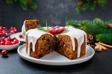 Traditional Christmas Fruit Cake, Pudding With Dried Fruits, Nuts And White Glaze.