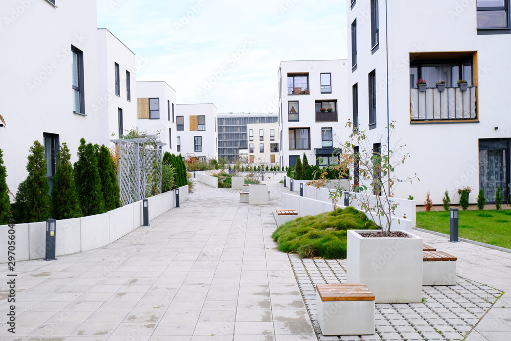 Fototapety, obrazy: Sidewalk in a cozy courtyard of modern apartment buildings condo with white walls.