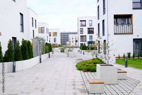 Sidewalk in a cozy courtyard of modern apartment buildings condo with white walls Fototapete