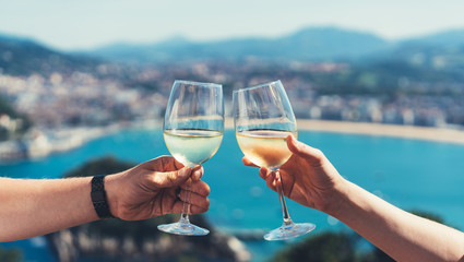 Drink two glasses white wine outdoor sea nature holidays, romantic couple toast with alcohol, happy people cheering fun vacation enjoying travel time together friendship love concept blure congrat