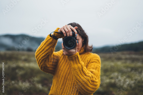 Obraz photographer tourist take photo on camera lens on background autumn foggy mountain, traveler hipster shooting video nature mist landscape, hobby vacation concept, copy space - fototapety do salonu