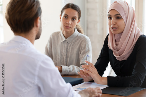 Asian muslim female hr manager interviewing applicant consulting client Fototapeta