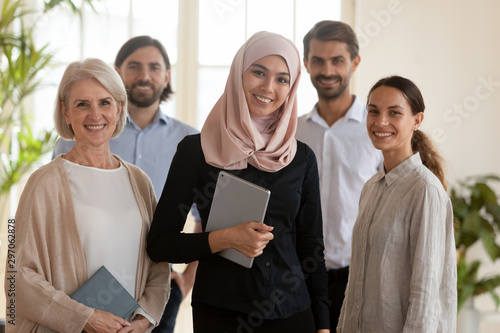 Confident happy asian muslim businesswoman manager and multicultural team portra Wallpaper Mural