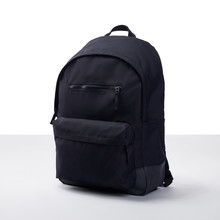 Black Backpack On A White-gray Background
