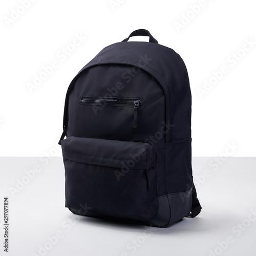 Obraz  Black backpack on a white-gray background - fototapety do salonu