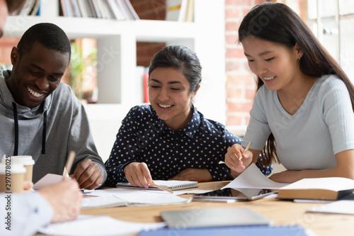 Fotografía  Indian, african, asian classmates do school assignment together indoors