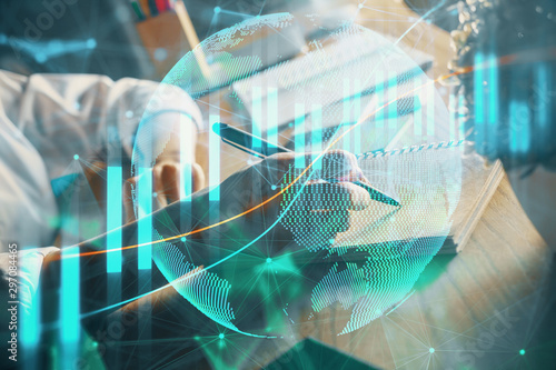Fotomural  Financial forex charts displayed on woman's hand taking notes background