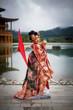 Leinwanddruck Bild - Young women wearing traditional Japanese Kimono at Japanese castle