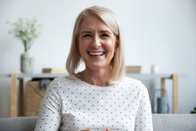 Happy Mature Old Woman Looking Talking To Camera At Home