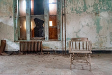 USA, New York, Ellis Island - May 2019: Old Furniture Abandoned In A Derelict Building