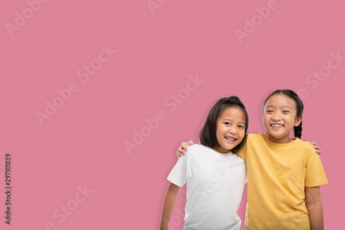 Little asian two girls laughing and smiling enjoy friendship together isolated f Fototapet