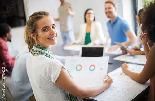 Team of colleagues brainstorming together while working in modern office Wallpaper Mural