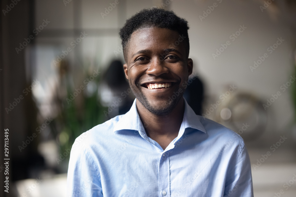 Fototapety, obrazy: Confident smiling young african businessman looking at camera in office