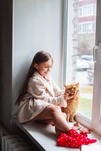 Little Girl In Teddy Robe Sitt...