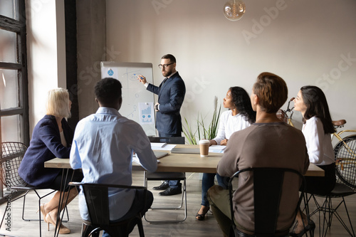 Fotografía  Serious businessman training speaker give presentation at company meeting